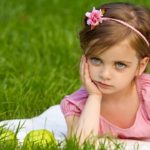 Girl pouting in grass